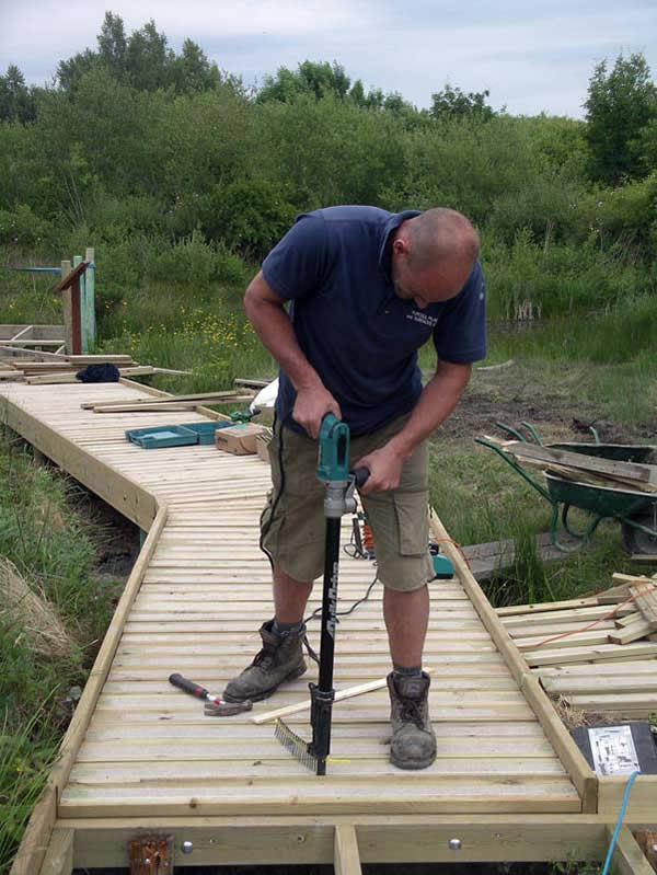 Installing the boards of the decking