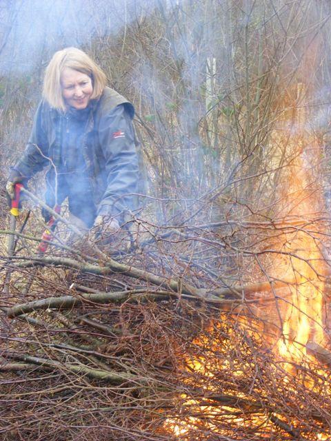 Beryl putting brash on the bonfire