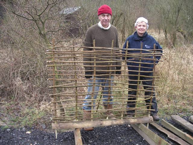 Heather and Chris building wattle panels
