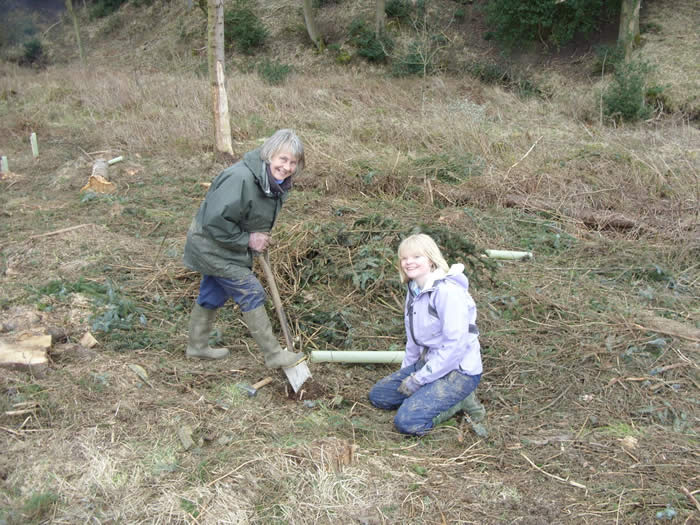 Val and Emma planting Alder buckthorn