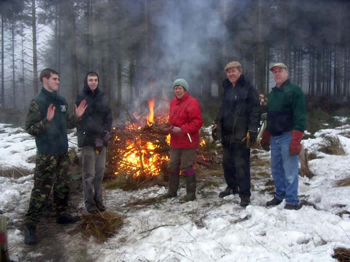 Volunteers with the bonfire
