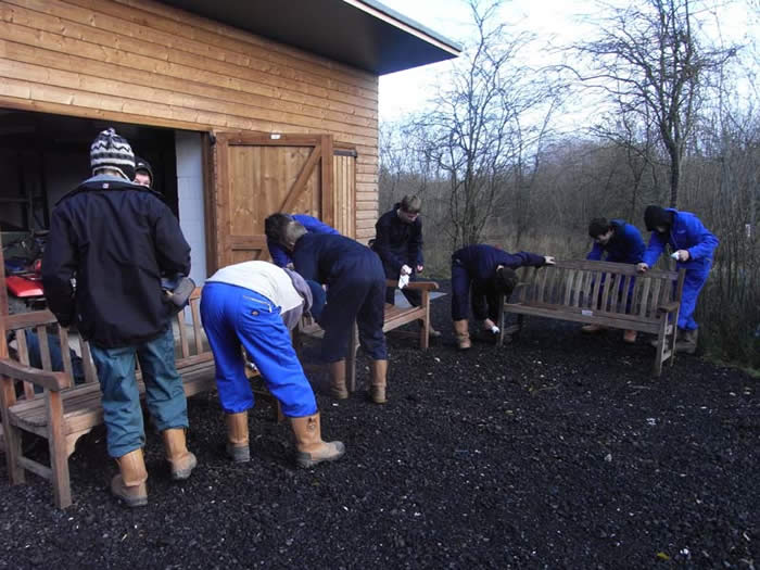 Askham Bryan students oiling the benches