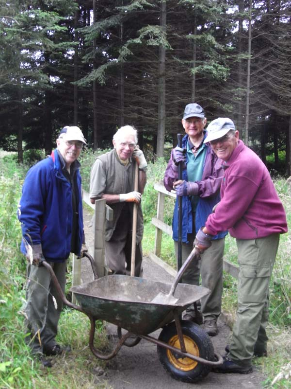 Colin, Jack, John and John repairing the ditch