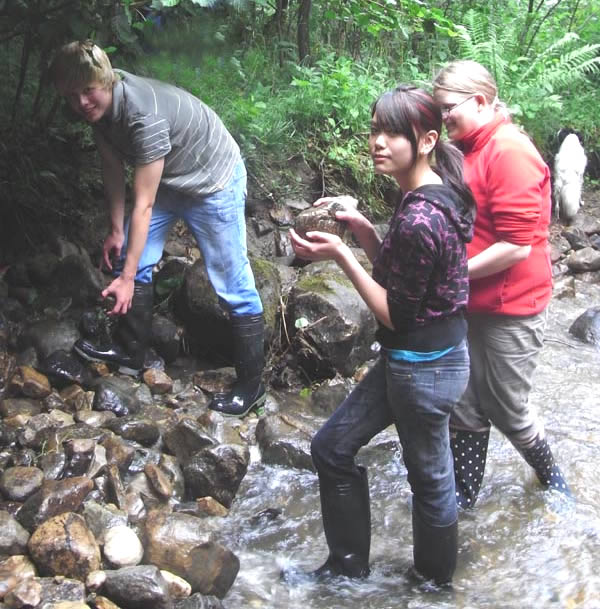 Naomi, Owen and Bethany re-building the dams