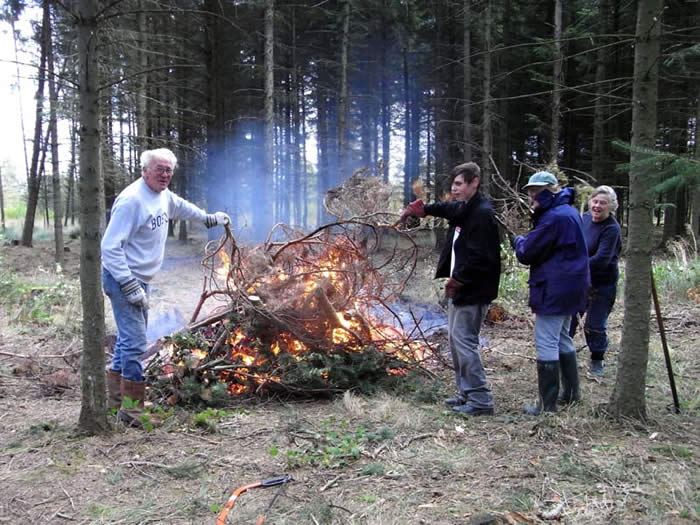 Volunteers by the bonfire