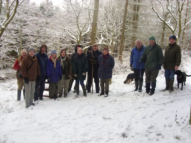 Volunteers working in the snow