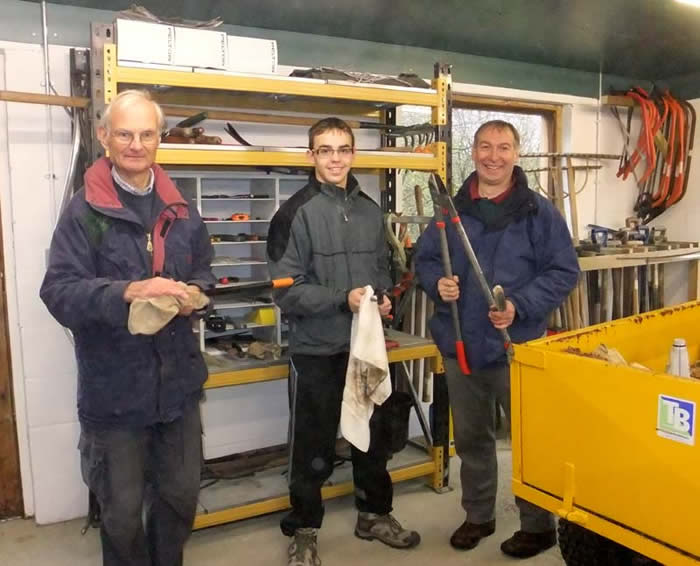 John, Thomas and Martin cleaning the tools