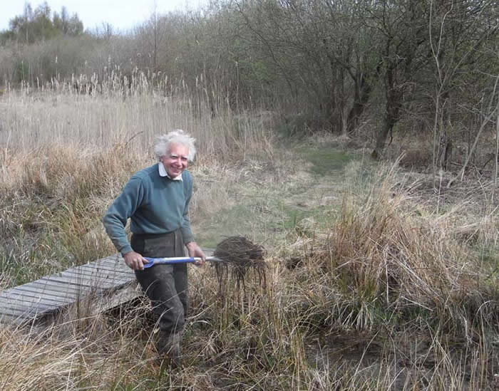 Colin digging to allow flow of water
