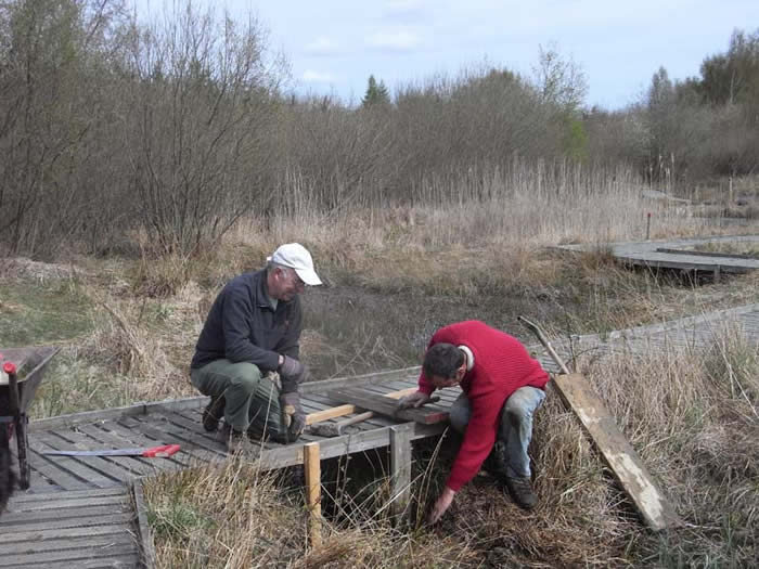 Richard and John repairing a dam