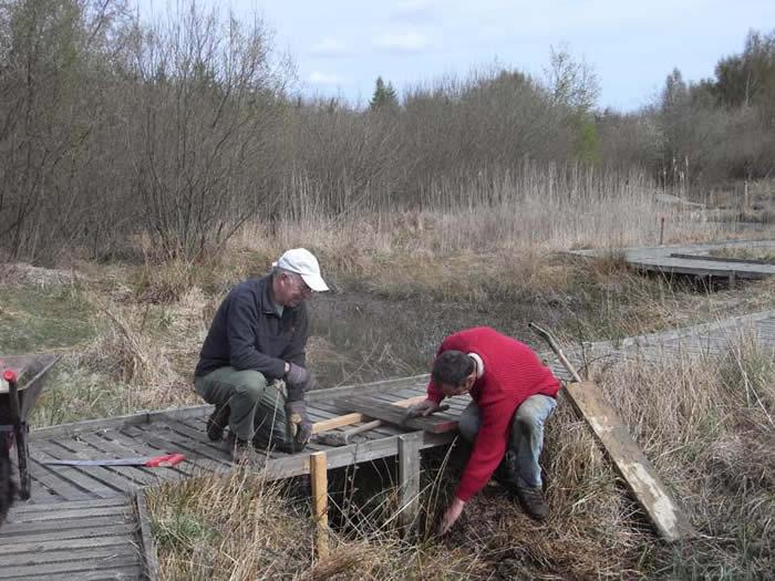Richard and John repairing a dam