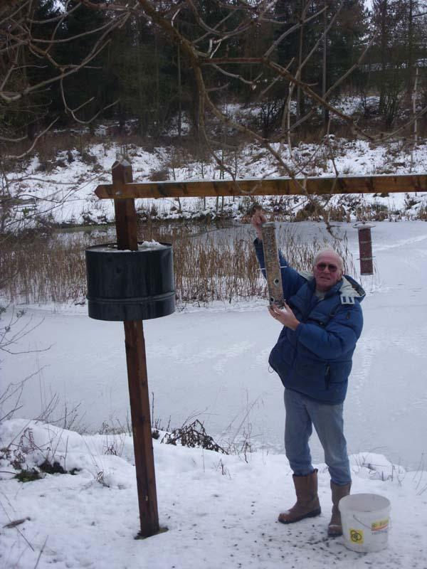 Filling the bird feeders