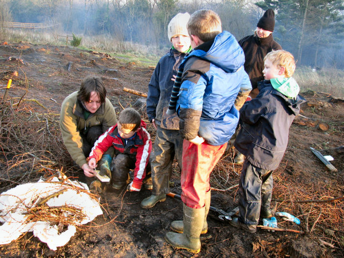Children lighting the bonfire