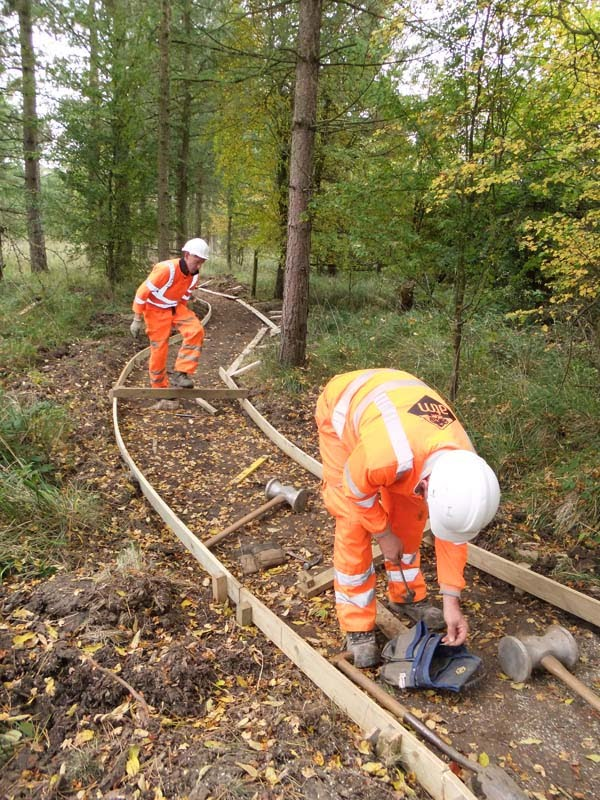 Workmen installing the new path