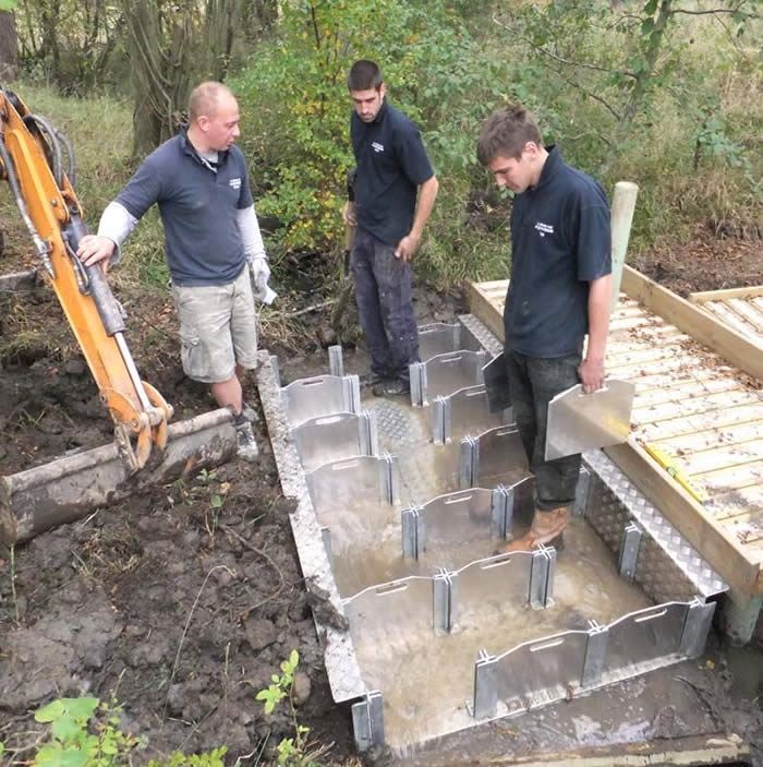 Steve's team working on the new sluice