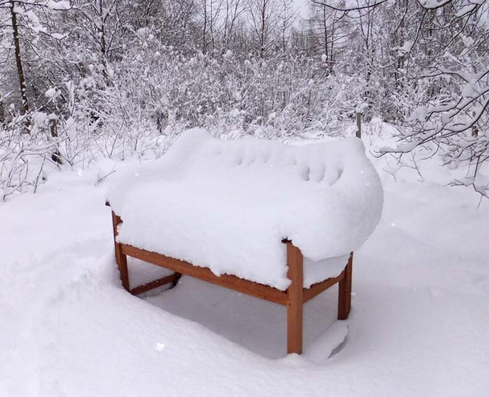 Seat covered in snow