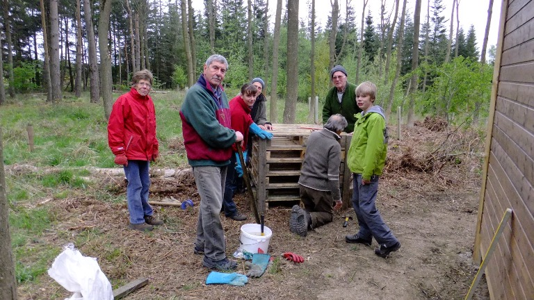 Volunteers make a bug hotel
