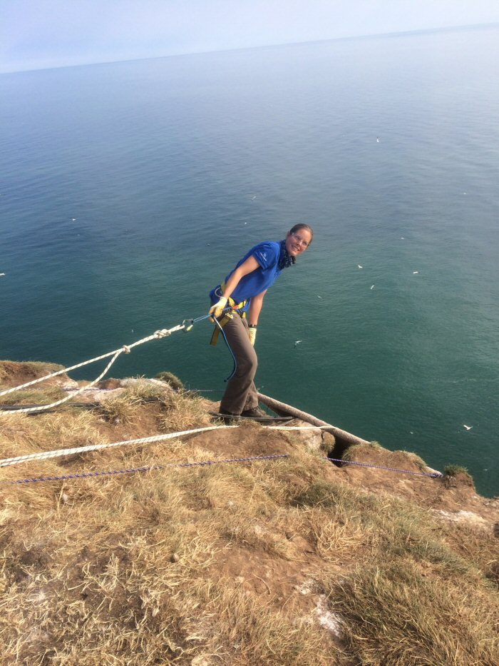 Stacey on the top of the  cliff - well roped on!