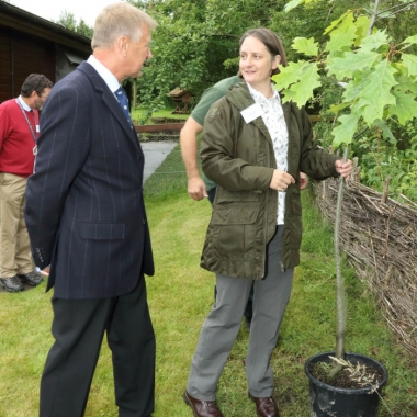 Sophie showing the LordLieutenant Barry Dodd where the Red Oak is to be planted